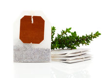 Teabag with green thyme herbs Stock Photography