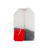 Teabag with red label isolated on a white Stock Images