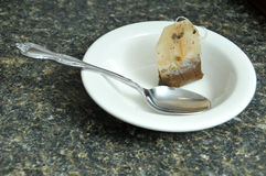 Teabag in small dish. Teabag in a small white ceramic dish Stock Photos