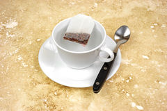 Teabag steeping in cup of hot water Royalty Free Stock Photo