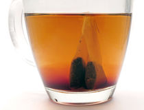 Teabag steeping in tea Stock Photo