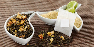 Teabag with Tea Leaves, Sugar and Lemon Stock Photo