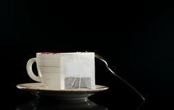 Teabag and Teacup. Teacup, teabag and teaspoon photographed on black Royalty Free Stock Photo