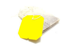 Teabag with yellow label Royalty Free Stock Photography