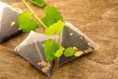 Teabags with melissa (mint) Royalty Free Stock Image