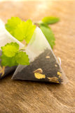 Teabags with melissa (mint) Stock Photo