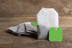 Teabags on wooden background Royalty Free Stock Image