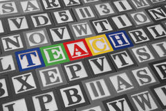 Teach. Colorful toy blocks spelling out the word teach Stock Images