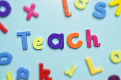 Teach. Magnetic alphabet letters spelling the word teach royalty free stock photo