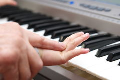 Teach child piano Stock Image