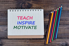 Teach Inspire Motivate on notebook. Page stock images