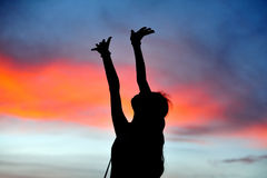 Teach the sky. Girl Silhouette teach the sky Royalty Free Stock Photo