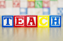 Teach Spelled Out in Alphabet Building Blocks Stock Image