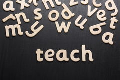 Teach in Wooden Letters Stock Image
