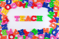 Teach written by plastic colorful letters on a white Royalty Free Stock Photography
