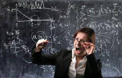 Teacher. Angry teacher with blackboard on the background stock photos