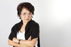 Teacher. Asian woman with serious face Stock Photo