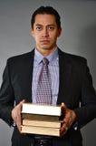 Teacher. This picture represents a teacher folding few books Stock Images