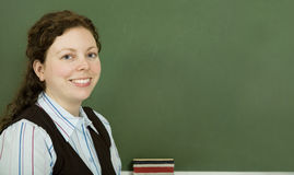 Teacher. Young teacher in front of a chalkboard stock photos