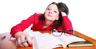 Teacher. The teacher is sitting at a table on an isolated background Royalty Free Stock Photos