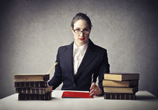 Teacher. Serious teacher sitting at her desk stock photos