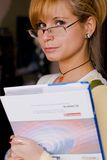Teacher. In glasses holding a book stock image