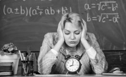 Teacher with alarm clock. Time. Study and education. Modern school. Knowledge day. School. Home schooling. Tired woman royalty free stock images