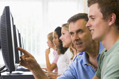 Free Teacher Assisting College Student In Computer Lab Royalty Free Stock Photography - 5949257