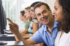 Free Teacher Assisting College Student On Computers Royalty Free Stock Photo - 5949325