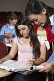 Teacher Assisting Female Student Royalty Free Stock Images