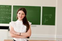 Teacher on background of blackboard royalty free stock photo