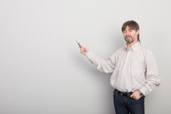 Teacher on the background of a gray wall Royalty Free Stock Photography