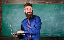 Teacher bearded man with modern laptop chalkboard background. Online education. Digital technology education. Modern. Technology education. Hipster teacher wear stock photos