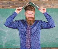 Teacher bearded man with modern laptop chalkboard background. School blows his mind. Can not get used to teachers. Lifestyle. Hipster teacher aggressive with royalty free stock photos