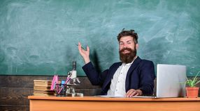 Teacher bearded man tell interesting story. Teacher interesting interlocutor as best friend. Telling educational stories. Teacher charismatic hipster sit table royalty free stock photo