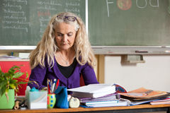 Teacher behind her desk Stock Photos