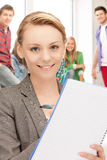 Teacher with big notepad at school. Picture of smiling teacher with big notepad at school Royalty Free Stock Photo