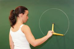 Teacher on the blackboard. To draw a circle Royalty Free Stock Photography