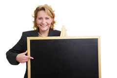Teacher with blackboard Stock Images
