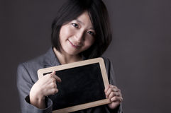 Teacher with blackboard. Happy woman in suit pointing to blackboard Stock Image