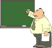 Teacher At A Blackboard Royalty Free Stock Photos