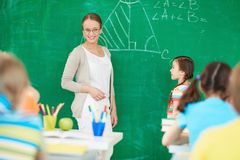 Teacher by blackboard Stock Photography