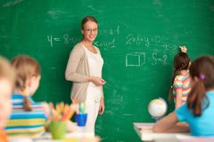 Teacher by blackboard Stock Image