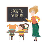 Teacher by blackboard with pupils Royalty Free Stock Photos