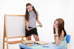 Teacher at blackboard teacher saw that she fell asleep Royalty Free Stock Images