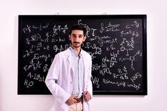 Teacher at the blackboard Stock Images