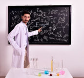 Teacher at the blackboard Royalty Free Stock Photography
