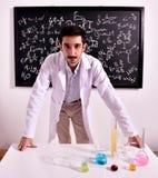 Teacher at the blackboard Royalty Free Stock Image