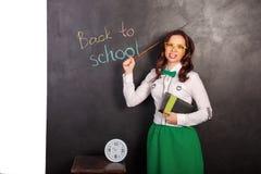 Teacher at the blackboard royalty free stock photo