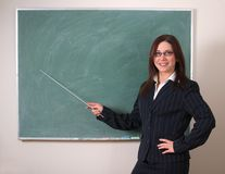 Teacher and blank chalkboard Stock Photography